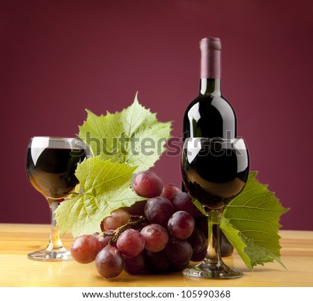 A still life composition with violet grape and wine.