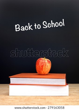 A still life conceptual image of going back to school - stock photo