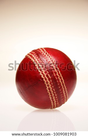 A STILL LIFE OF CRICKET BALLS ON A PLAIN BACKGROUND