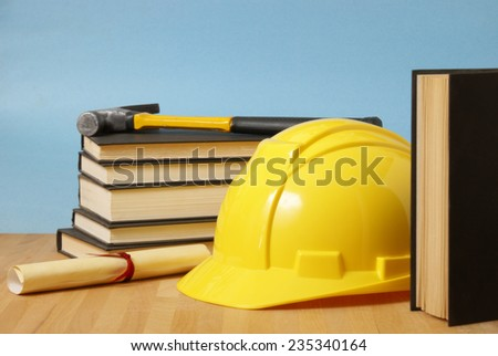 A still life of objects representing a trade school student. - stock photo