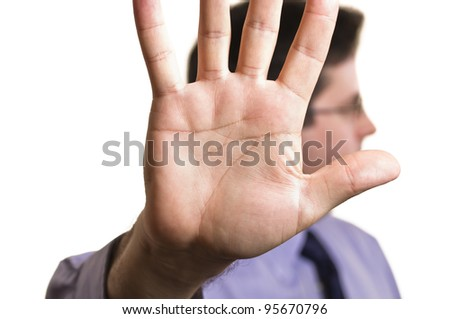 A stock photo of a business man blocking the camera