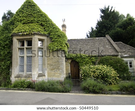 A stone built English old fashion school house in the Cotswold's area. - stock photo