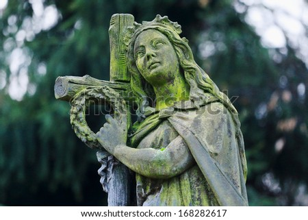 A stone Girl on a Tomb at the old Prague Cemetery, Czech Republic