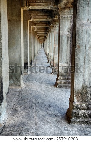 A stone hallway that is part of the Angkor Wat temple complex near Siem Reap Cambodia.
