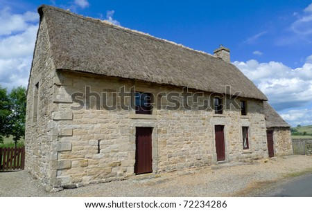 A stone house in rural area - stock photo