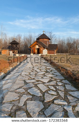 A stone path to an orthodox church in Velika Plana etno village in Serbia - stock photo