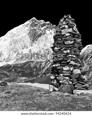 A stone pyramid against of khumbu glacier (black and white), Nepal
