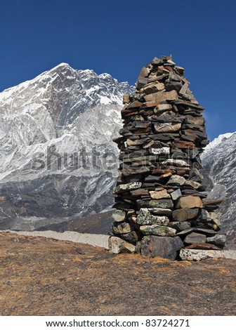 A stone pyramid against of khumbu glacier - Nepal - stock photo