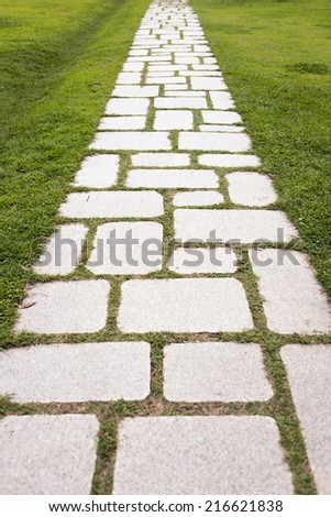 a stone road with grass in the soeul forest park. - stock photo