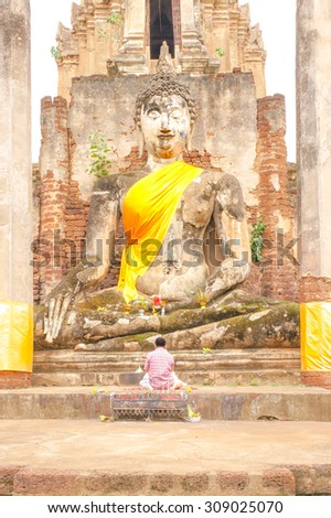 """A Stone Sculpture of Great Buddha [Sukhothai Style architecture], At """"Wat Mahathat"""" in Sukhothai Historical Park, Sukhothai Province, Thailand. [Original Warm Collection] - stock photo"""