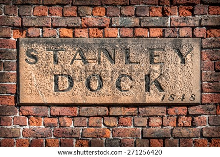 A stone sign on the wall of the historic Stanley Dock tobacco warehouse, Liverpool. - stock photo