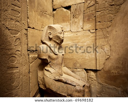 a stone statue in the karnak temple in luxor - stock photo