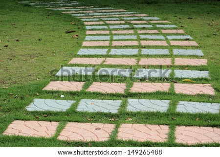 A stone walkway in the garden - stock photo