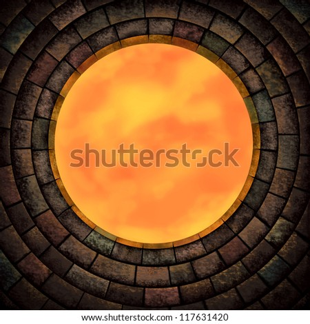 A stone wall with a round window - stock photo