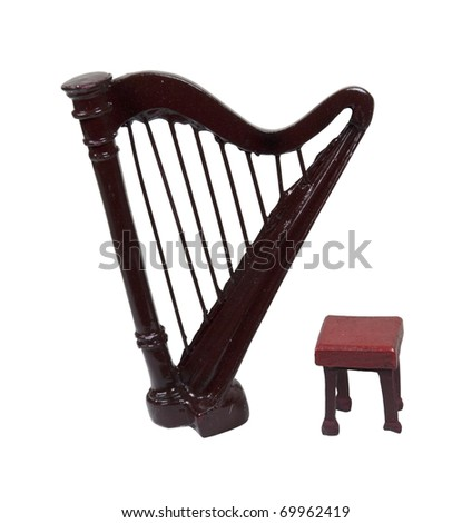 A stool and a harp which is a stringed musical instrument - path included