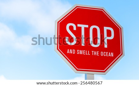 "A ""stop and smell the ocean"" traffic, street sign in southern California"
