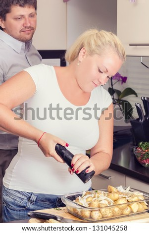 a stout woman in the kitchen - stock photo