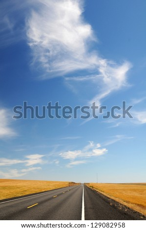 A straight road and the blue sky - stock photo