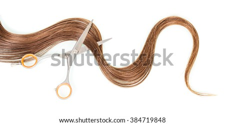 A strand of female hair and scissors isolated on white background. - stock photo
