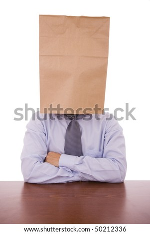 A strange business man with a cardboard bag on his head