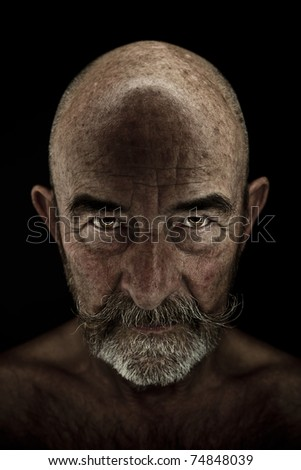 A strange old man with a grey beard - stock photo