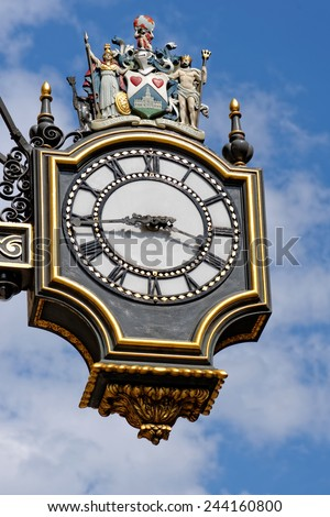 A street clock on the Royal Exchange building on Threadneedle street in London. - stock photo
