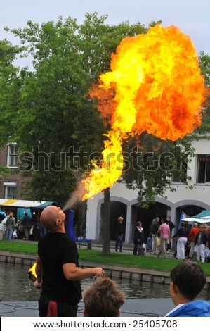 A street entertainer breathing fire in front of a large crowd of people,Schravendeel,Holland