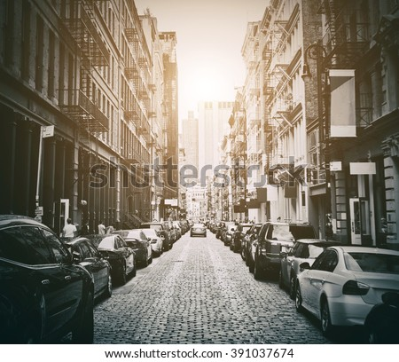A street in New York's Soho area with vintage sun effect