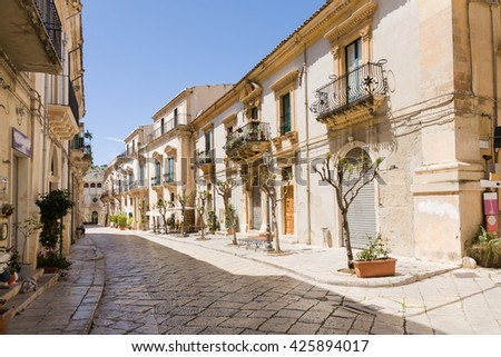 A street in the Sicilian baroque town of Scicli in southern Sicily, Italy