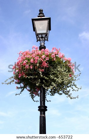 A street lamp decorated with bright flowers. - stock photo