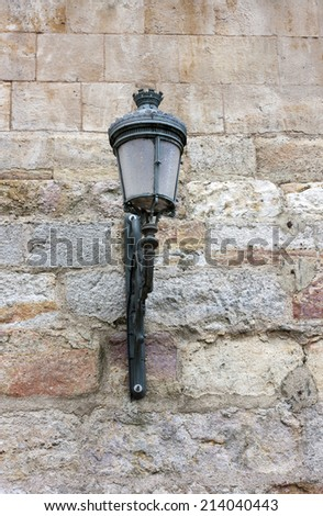 A street lamp on a wall