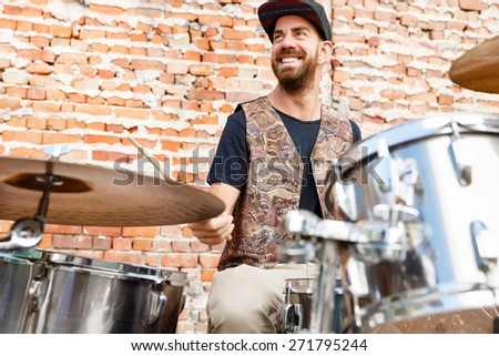 A street muscian playing drums - stock photo