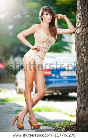 A street portrait of a beautiful  sexy young woman .Fashion sexy model on the street - stock photo