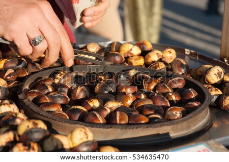 A street vendor roasting chestnuts in Istanbul, Turkey