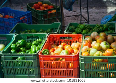 A street vendor sells vegetables along the road in Belize - stock photo
