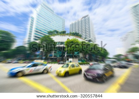 A Street View Of The Orchard Road In Singapore With The Motion Blur. The Orchard Road Longs 2.2 Kilometers And One Of The Major Tourist Attractions And Entertainment Hub Of Singapore - stock photo