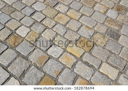 a street with cobblestones