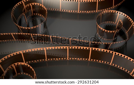 A strip of blank old vintage camera film curled up on an isolated studio background