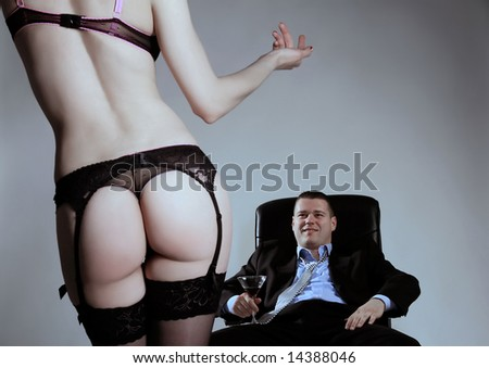 a stripped young business lady is calling  her boss - stock photo