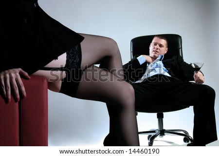 a stripped young business lady with her boss - stock photo