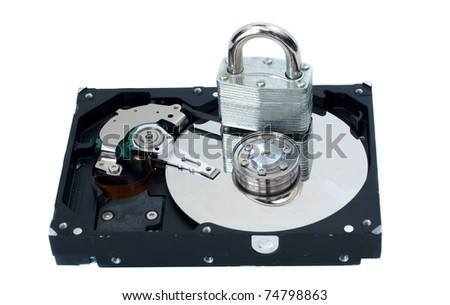 A strong lock sitting on a hard drive to represent security. - stock photo