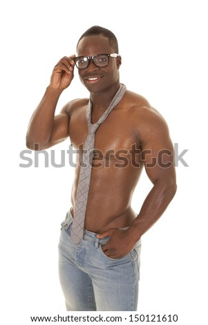 A strong man without a shirt on with a neck tie and glasses. - stock photo