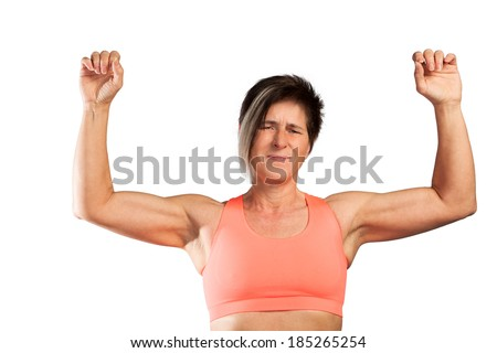 A strong woman shows her muscles isolated on a white background.