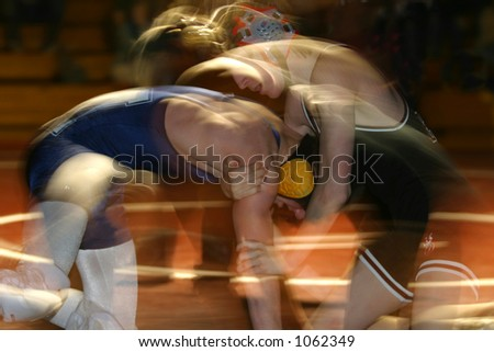 A struggle. Wrestlers in motion.