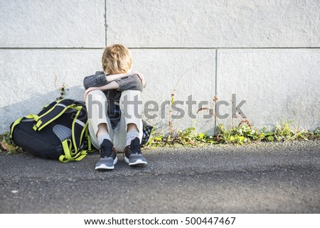A student boy outside at school standing