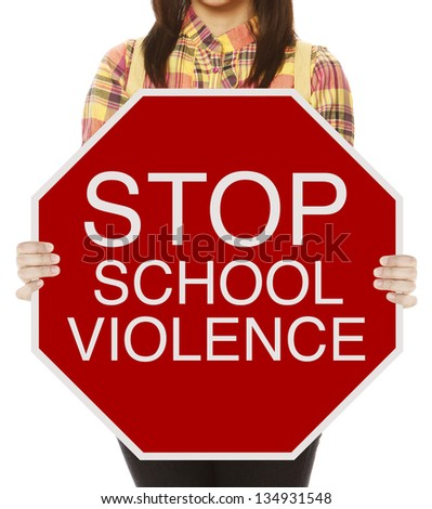 A student holding a conceptual stop sign on school violence