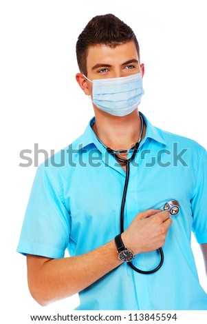 A student is auscultating his heart - stock photo