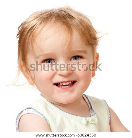 A studio head and shoulders portrait of a happy two year old girl.