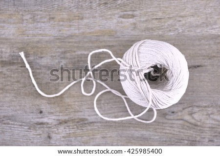 A studio photo of a ball of string