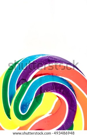 A studio photo of a candy swirl lollypop